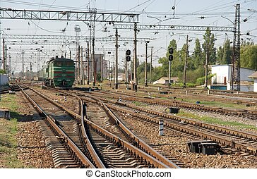 Railway - Complex railway track system with a green...
