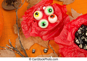 Assorted Halloween candy, treats for kids in spooky shapes