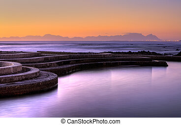 Tidal Pool Round - Gordons Bay tidal pool at sunset with...
