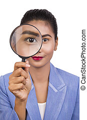 Business woman with a magnifier.