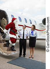 Santa Travelling on Private Jet - Santa thanking pilot and...