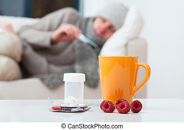 Man in bed having a cold