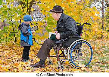 Young boy with his disabled grandfather - Young boy in the...