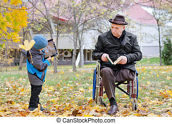 Disabled grandfather watching his grandson - Disabled...