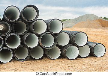 stack of ribbed pipes