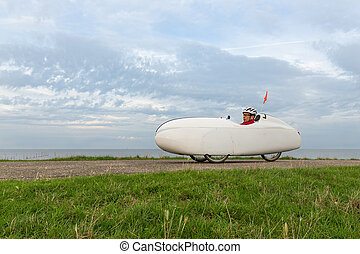 Velomobile bicycle along Dutch coast