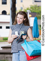 Woman Shopping Spending Limit - Young woman on a shopping...
