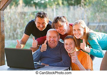 Family thumbs up - Happy family visiting grandfather,...