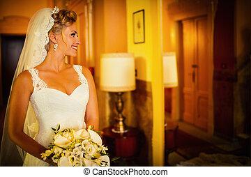 Bride at a mirror