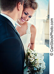 Tenderness - Young happy bride and groom
