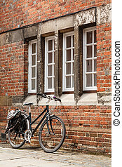 Vintage bicycle - Retro bicycle leaning against an old brick...