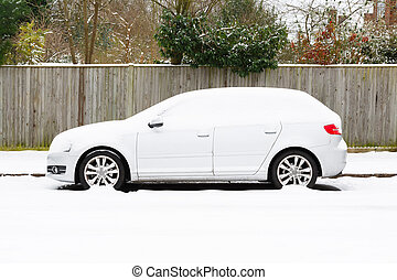 Car covered in snow - Parked European car covered in snow in...