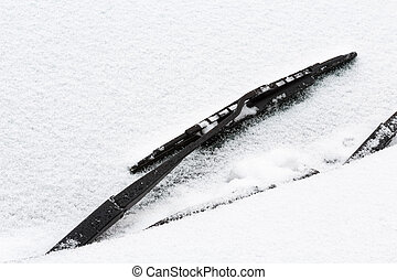Windshield wiper with snow - Detail of car front windscreen...
