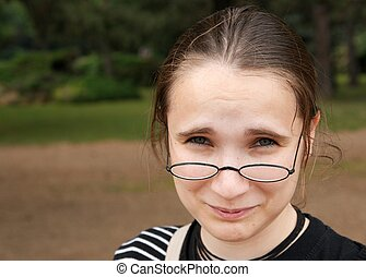 Girl with glasses looking confused