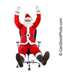 Young Santa Claus sitting on an office chair. - Young Santa...