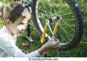 Kid who fix bikes - Child who fix bikes. Boy and bicycle