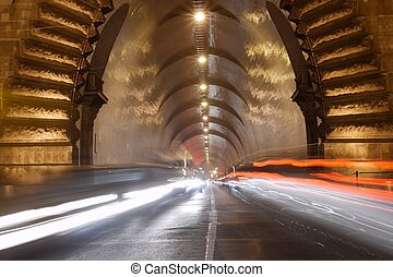 Tunel - Heavy traffic entering a tunel by night, motion blur