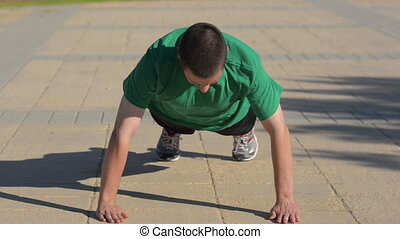 Push ups with clapping - Chap doing push ups with clapping