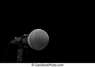 Microphone - Dynamic microphone on stand isolated on black