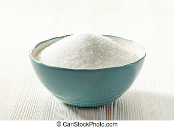 white sugar in a bowl - white sugar in a blue bowl