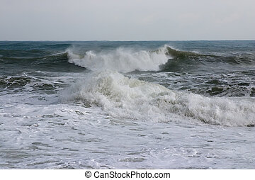 Waves and sea foam - Wave and sea foam on the shore of the...