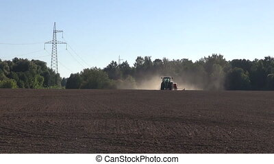 agriculture tractor sowing seeds on autumn farm field