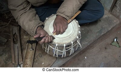 new indian tabla drum in musical instrument masters hands,...