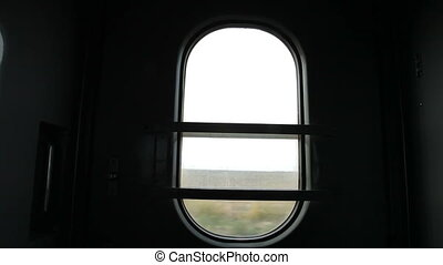 Inside the railroad car - View through the window of...