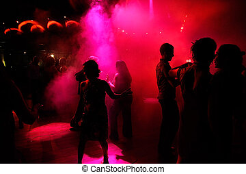 Dancing people in an night club.