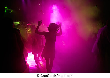 Dancing people in an night club