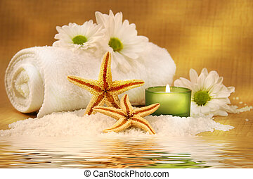 Green candle and towel - Starfish and green candle near...