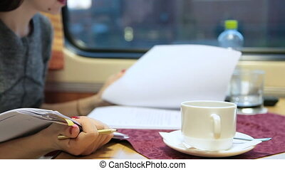 Business travel by sleeper train - Business woman working on...