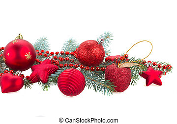 fir tree branch and red  christmas decorations