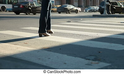 Zebra crossing - Woman crossing street at crosswalk