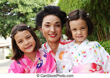 Japanese family - Portrait of a Japanese mother with her two...