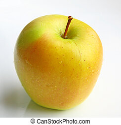 Wet yellow apple on white background