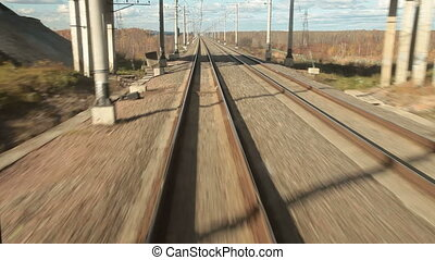View of railroad tracks from last carriage a train
