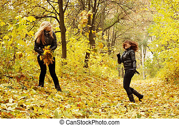 friends throw leaves