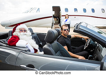 Santa And Driver In Convertible With Jet in Background -...