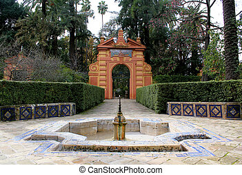 Courtyard at the Real Alcazar Moorish Palace in Seville,...