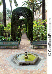 Water feature at the Real Alcazar Moorish Palace in Seville,...