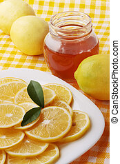 remedy for chilled - Flavored honey and lemon on a plate