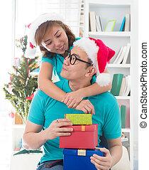 asian couple life christmas celebration gift sharing