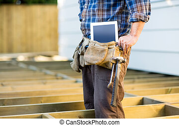 Construction Worker With Tablet Computer And Hammer In...