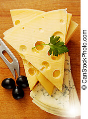 cut Swiss and blue cheese - a large piece of Swiss cheese...