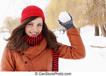 throwing snowball - woman in a red cap throwing snowball