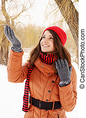 Happy woman catches snow - A young woman catches snowflakes...
