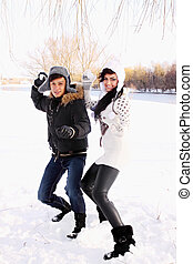 couple throwing snowballs - happy couple throwing snowballs...