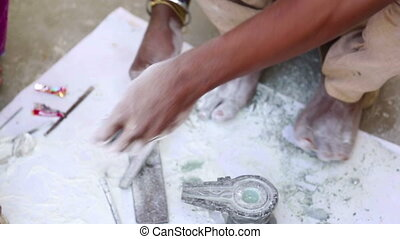 Stone carving - Indian craftsman carving a piece onix in the...