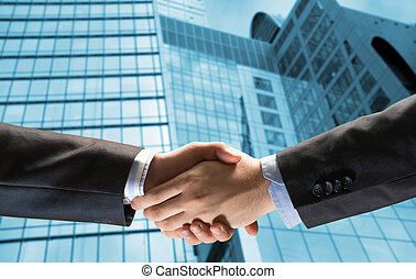handshake of two businessmen on the background of business...